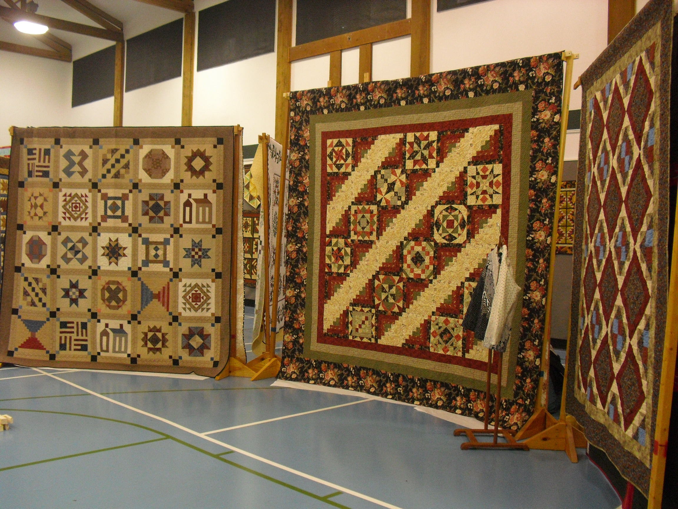 Display of beautiful quilts made by the village's quilting club