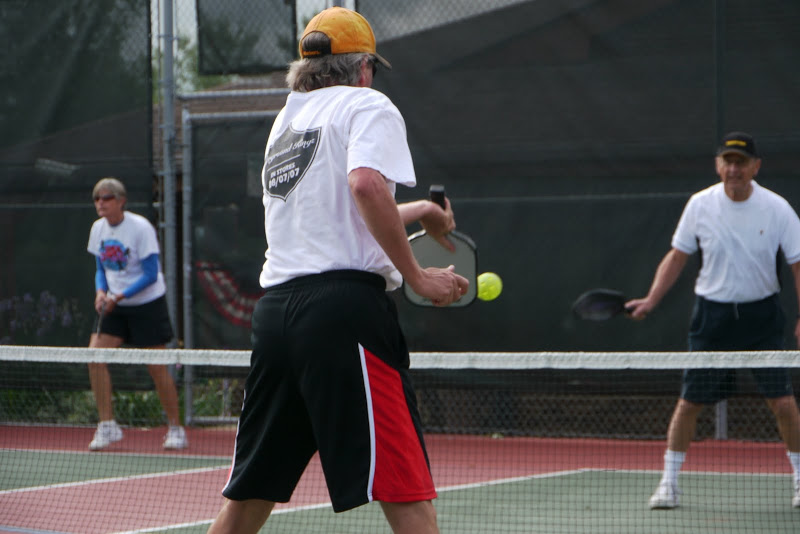 Residents playing pickleball.