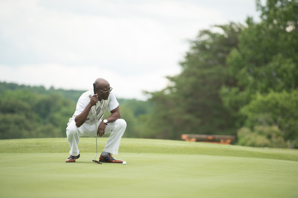 Golfer checking on his putt at the Links at Kahite Golf Course.