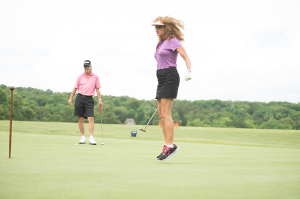 Golfer jumping for joy at the Links at Kahite golf course.