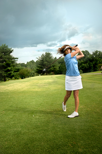 Golfer taking a swing at the Tanasi Golf Course