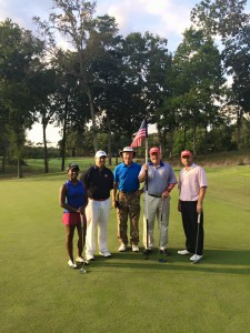 Tellico Village's PGA professional staff gathered around the flag at the 18th green to celebrate their Folds of Honor challenge recently. Casey Flenniken, far right, made the most birdies, 7, and the whole team carded 15 birdies total raising in excess of $5,000 for the Folds of Honor Foundation. On a side note, the Titleist team of Casey and Jim West, second from right, defeated the Callaway team of Adam Jacob, second from left, and Peyton Ritchie, far left. Jeff Harrington, in the center, dazzled the attending crowds with his camo wardrobe.