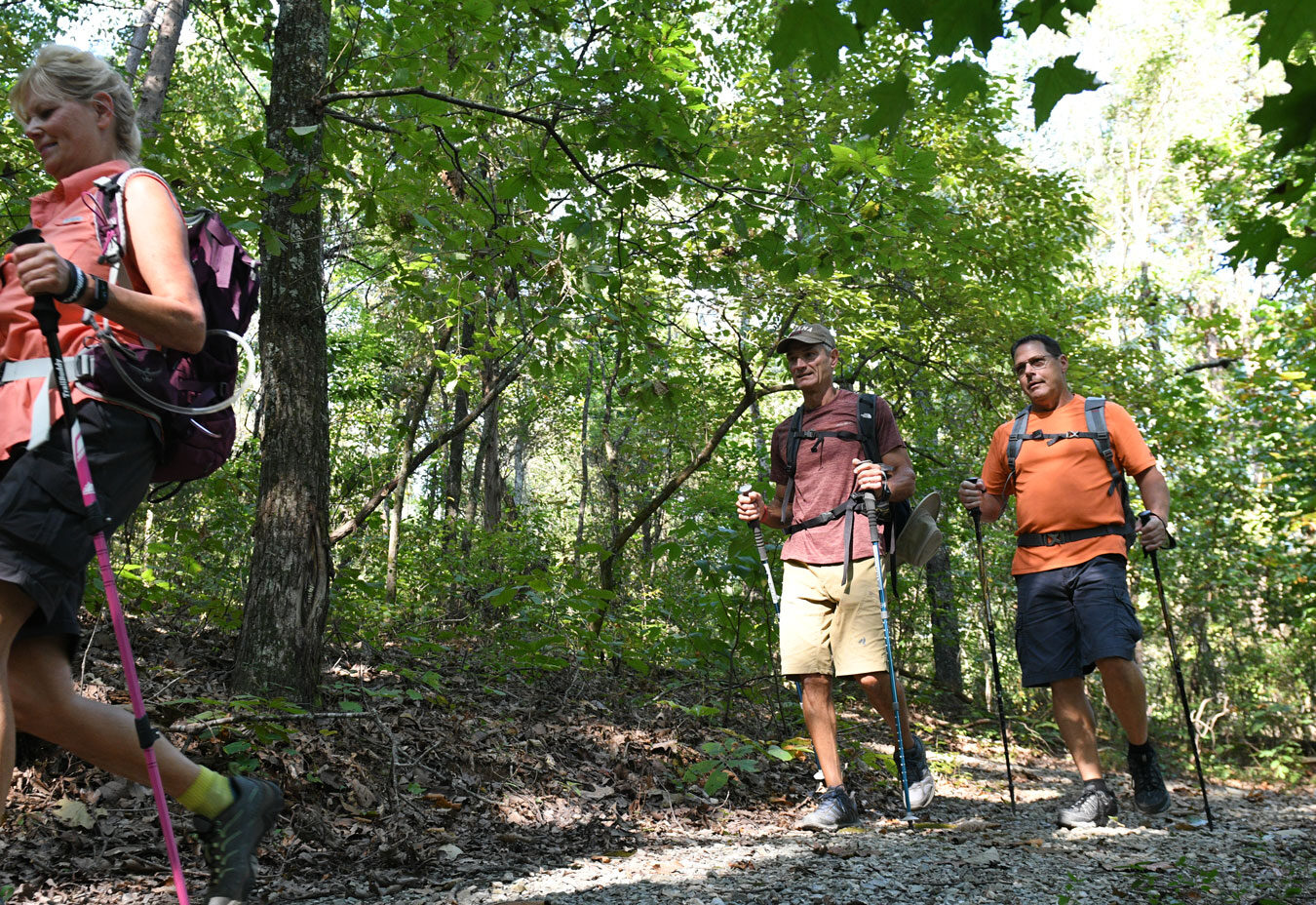 Villagers hiking on one of the Tellico Village hiking trails.
