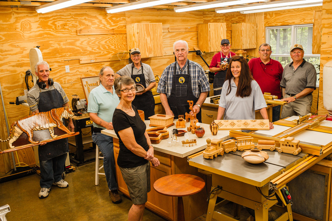 Members of Tellico Village Woodworkers Clubs showcasing their creations.